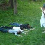 """[en]: the participants lie on the grass in front of """"the emperor"""""""