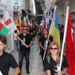 Volunteers with national flags