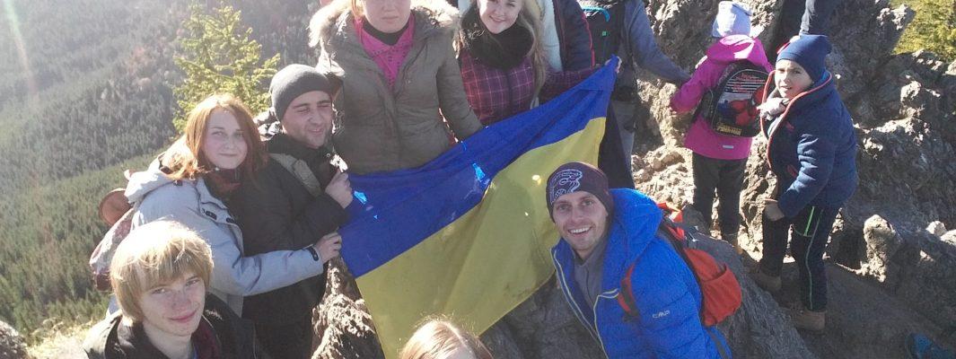Ukrainian flag is on the mountain