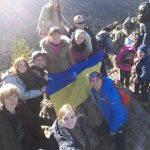 Ukrainian flag is on the mountain