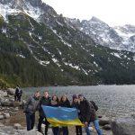 We with Ukrainian flag near the lake