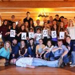 Volunteers form word ERASMUS+